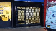 Your Business A New Look Of Security With Punch Hole Roller Shutter
